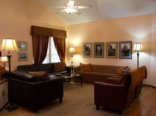 Living room with leather furniture and pictures of English gardens